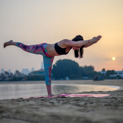 yoga at the beach during sunset.jpg