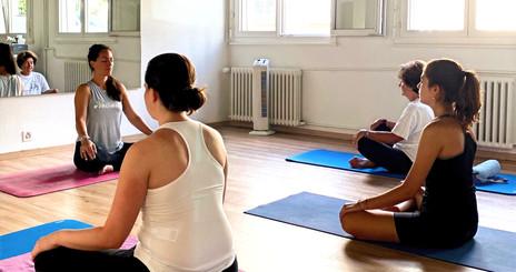 yoga%20group%20class%20focusing%20on%20b