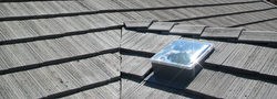 Sun Glo solar tube on  flat tile