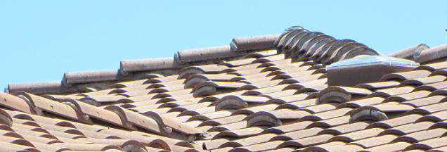 The Sun Glo solar tube on a spanish tile roof_edited.png