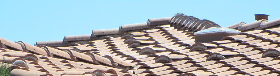 The Sun Glo solar tube on a spanish tile roof.png