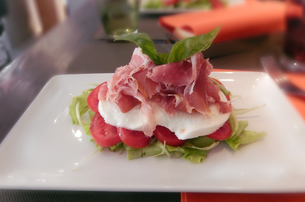 Caprese salad with prosciutto at Impronta