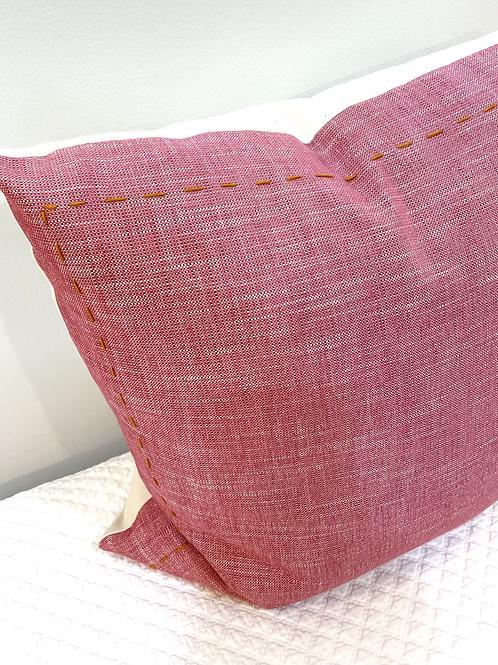Pink pillow orange stitched boarder