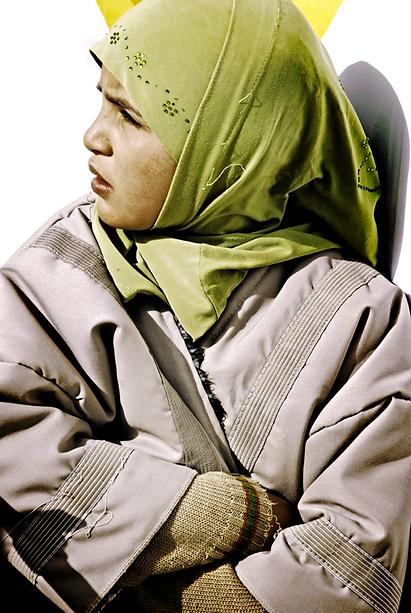 Girl with green hijab.