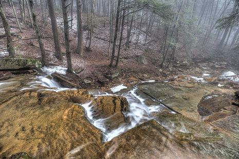 Peeking over the top Rapp Run Falls