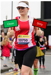 "runner holding a sign saying ""clean"" in the right hand, and another sign saying ""dirty"" in left hand"