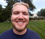 Councelor named Luke smiling