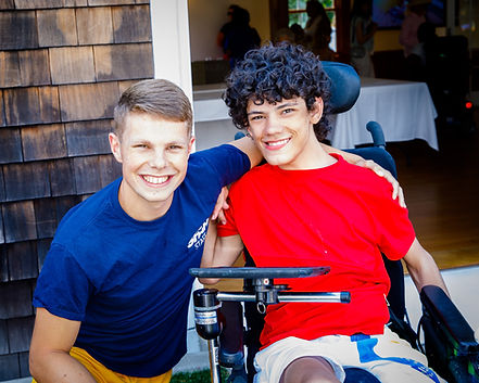Camper and counselor smiling at special needs camp for kids