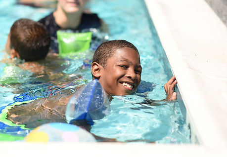 Boy in pool at special needs camp
