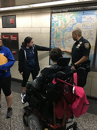 Teen in wheelchair in front of map