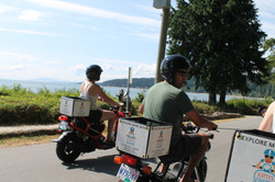 Man and woman on scooters