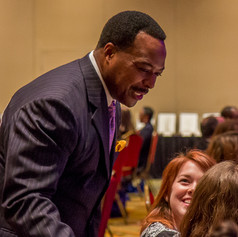 Leon Harris, ABC7-WJLA, mingles with guests at the 2014 AWE Awards Luncheon
