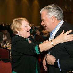Ms. Mary Ellen Savarese greets  Mr. Chuck Cochran at the 2015 AWE Award Luncheon