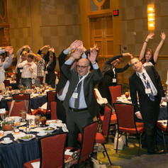 Luncheon attendees participating in the stretch break