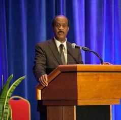 County Executive Isiah (Ike) Leggett congratulates the 2013 AWE winners