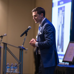 Event emcee, Jessob Reisbeck (Good Morning Washington) welcome guests and explains the AWE awards to event guests.