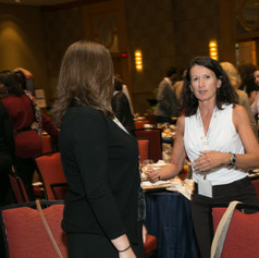 Attendees at the 2015 AWE Awards Luncheon make introductions