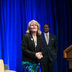 Ms. Judy Ashley, Chariman of AWE's Board of Directors, led luncheon guests in a short stretch break