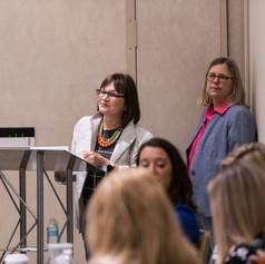 Monica Schaeffer introduces presenter, Lori A. Trawinski, Ph.D., CFP®