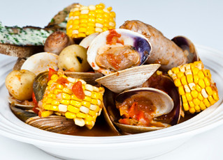 Little Neck Clam Boil with Baby Potatoes, Smoked Sausage and Sweet Corn