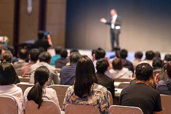 rear-side-audiences-sitting-listening-speackers-stage.jpg