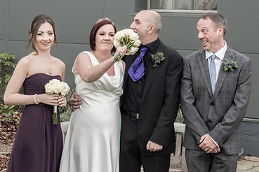 's faceBride stuffing flowers into groom's face. funny wedding photography