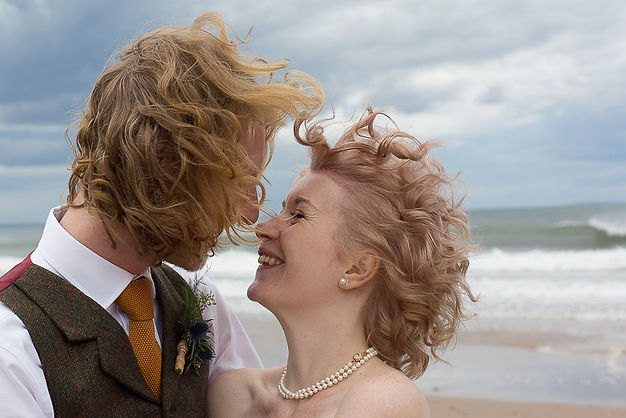 Couple on the beach. Wedding Photography Bristol and Bath, just married and so in love,