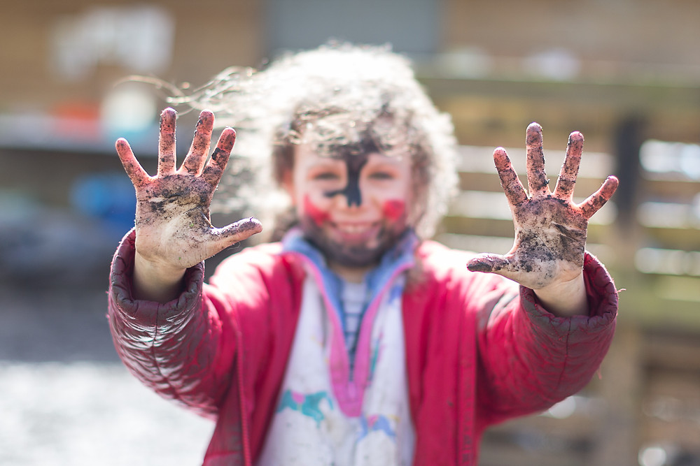 Muddy hands at forest school