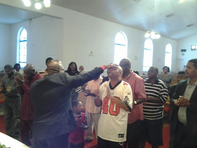 men receiving prayer