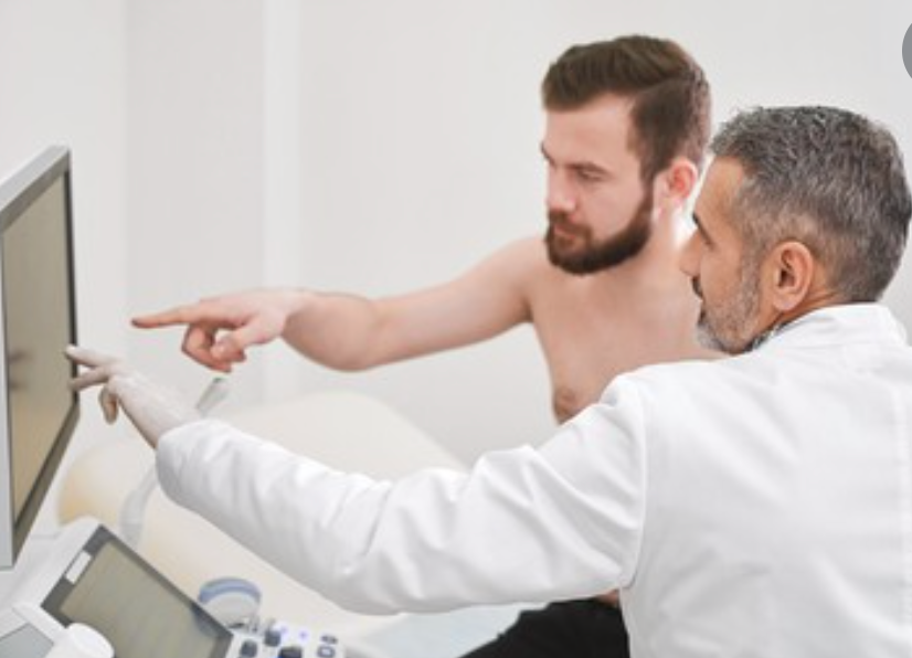 doctor examining a man for symptoms of erectile dysfunction