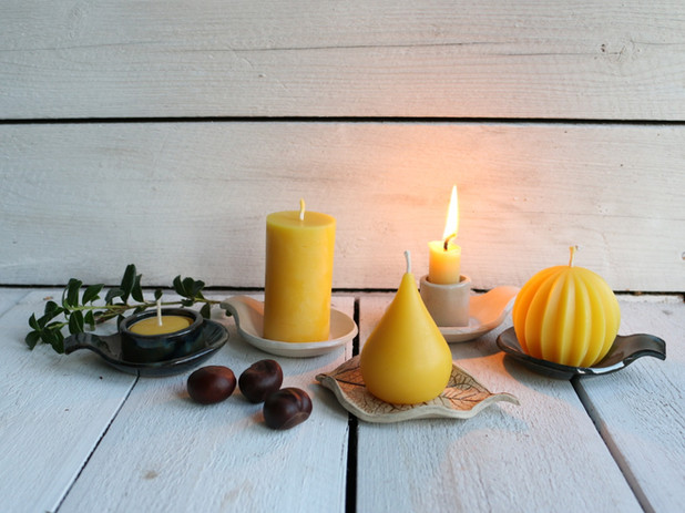 Ceramic candle plates and beeswax candles.