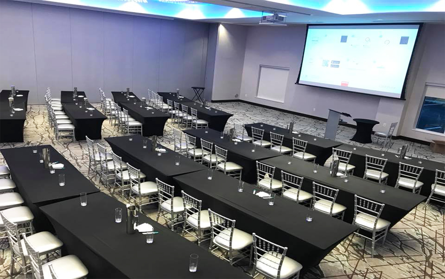 A presentation room with tables