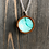 Thumbnail: Teal Daisy Hand Painted Alcohol Ink Wood Circle Pendant Necklace