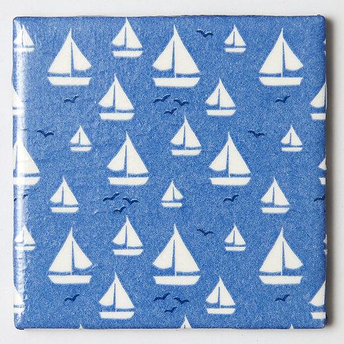 White Sailboats on Blue