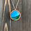 Thumbnail: Green and Blue Alcohol Ink Wood Circle Pendant Necklace