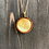 Thumbnail: Beige Gold Alcohol Ink Wood Circle Pendant Necklace