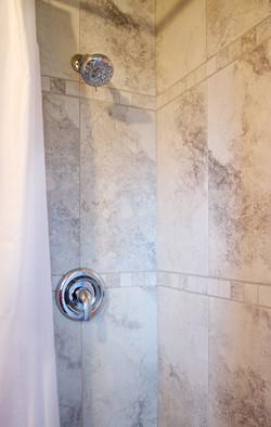 washroom with new tiled shower