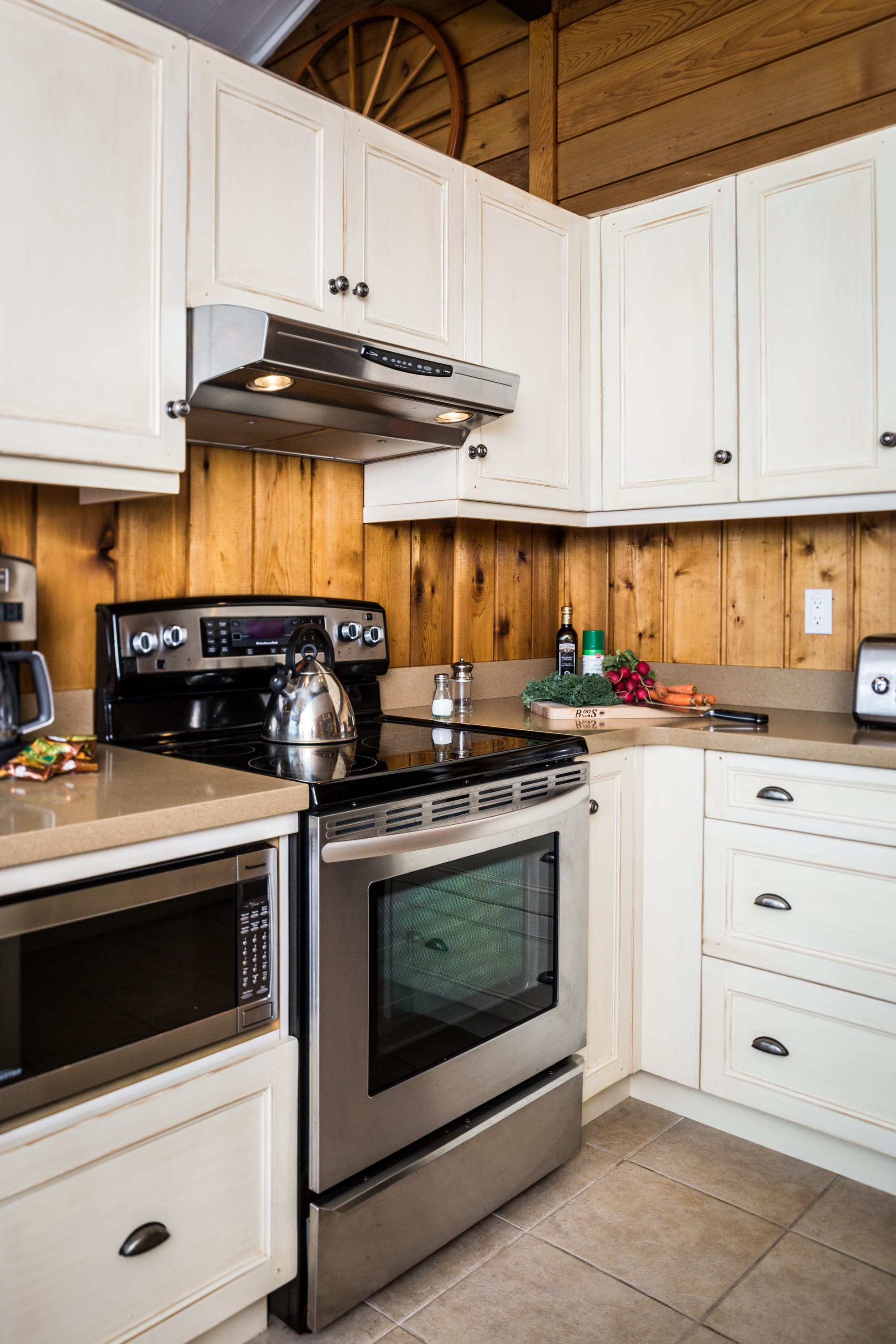 Evergreen-Kitchen newly renovated with custom cabinetry, microwave, & stove.