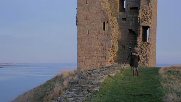 Cat Auburn filming at Dunstanburgh Castle in Northumberland, UK. (making-of) 'Preparing the Ground' (2017).