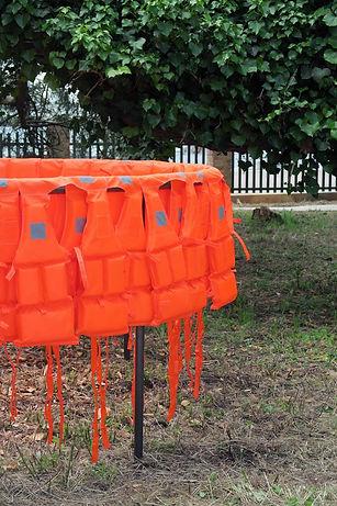 Paul Handley, Déplacement (Smuggling Pod), 2017. Life-jackets, Steel, 200cm diameter x 100 cm. Installation at Giardini Marinaressa, Venice. Image: HUM
