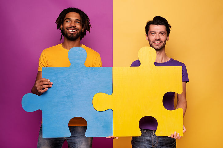 happy-friends-with-puzzles-hand-yellow-concept-integration-union-partnership (1).jpg