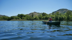 Canadian canoe backdropped by Arnison Crag & Birks