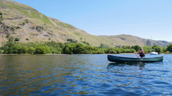 Canadian canoe backdropped by Place Fell
