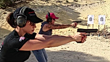 Women shooting pistols