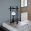 Minimalist black matt table lamp with milk glass shade on the primitivist stone table in a Japanese design inspired bedroom