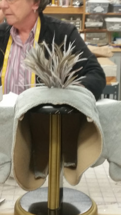 Suessical - laid feathers into cap