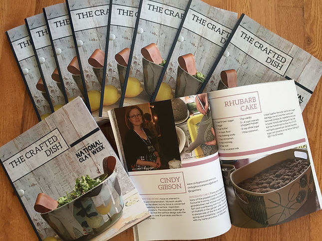 """Photo of cookbooks called """"The Crafted Dish"""", with one opened to Cindy Gibson Ceramics page."""