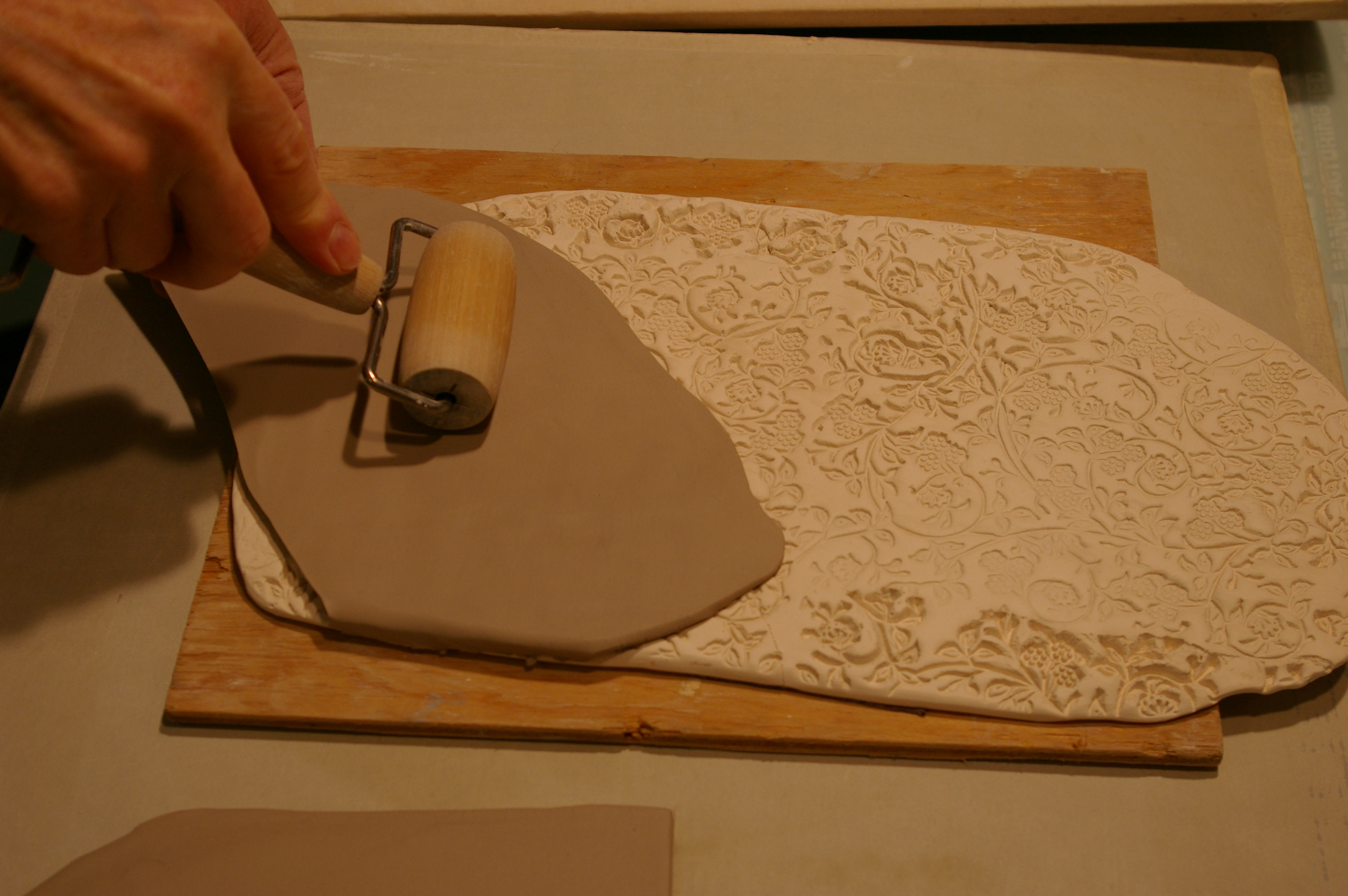roll over a textured fired clay slab