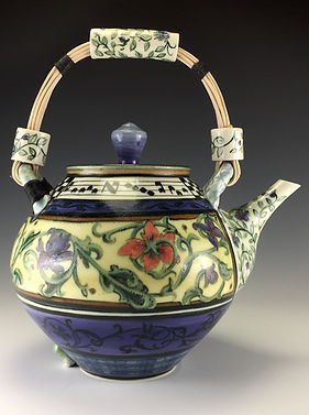 Custom large porcelain teapot with medieval floral pattern and reed over top handle by Cindy Gibson.
