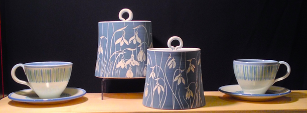 Handmade porcelain pottery jars with snowdrop design